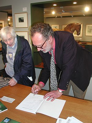 Peter signing a copy of his latest book