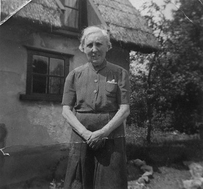 Miss Chevalier outside School Cottage (now rebuilt)