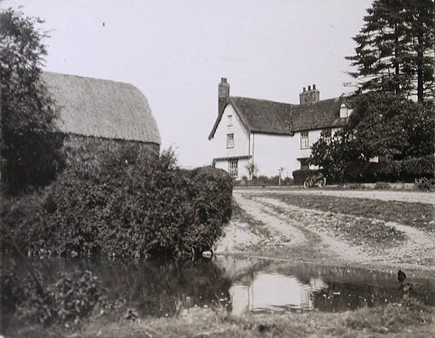 Kettlebaston Hall viewed across the moat  - c.1930